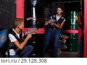 Купить «Young friends with laser guns playing laser tag game in dark room», фото № 29128308, снято 23 августа 2018 г. (c) Яков Филимонов / Фотобанк Лори