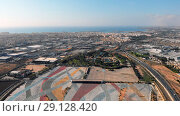 Купить «Aerial photography Torrevieja townscape. Above view of empty market parking area, square for transport. Friday many tourists and vacationers buy foodstuffs and clothes there. Costa Blanca. Spain», фото № 29128420, снято 19 июня 2019 г. (c) Alexander Tihonovs / Фотобанк Лори