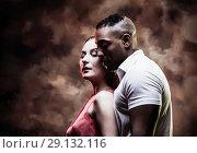Купить «Young and sexy couple dances Caribbean Salsa», фото № 29132116, снято 22 ноября 2019 г. (c) Игорь Бородин / Фотобанк Лори