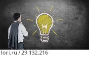 Купить «Digitally generated video of businessman looking at electric bulb 4k», видеоролик № 29132216, снято 24 марта 2019 г. (c) Wavebreak Media / Фотобанк Лори
