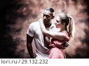 Купить «Young and sexy couple dances Caribbean Salsa», фото № 29132232, снято 22 ноября 2019 г. (c) Игорь Бородин / Фотобанк Лори