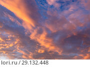 Купить «Abstract background with a texture of clouds at sunset. Heavenly landscape. A beautiful morning blue sky painted in the sun in bright red and orange colors», фото № 29132448, снято 25 сентября 2018 г. (c) Светлана Евграфова / Фотобанк Лори