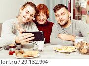 Купить «Young couple making selfie with senior woman», фото № 29132904, снято 27 ноября 2017 г. (c) Яков Филимонов / Фотобанк Лори