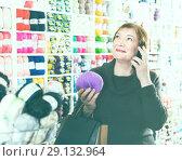 Купить «Senior woman using smartphone after shopping», фото № 29132964, снято 10 мая 2017 г. (c) Яков Филимонов / Фотобанк Лори