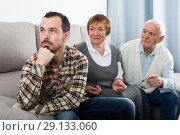 Купить «Parents arguing with son», фото № 29133060, снято 19 февраля 2019 г. (c) Яков Филимонов / Фотобанк Лори