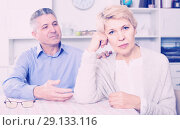 Купить «Husband and wife arguing with each other and try to resolve family conflict at table», фото № 29133116, снято 20 марта 2019 г. (c) Яков Филимонов / Фотобанк Лори