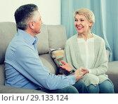 Купить «friendly mature married couple in house are warmly reconciled after quarrel», фото № 29133124, снято 20 октября 2018 г. (c) Яков Филимонов / Фотобанк Лори