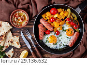 Купить «fried eggs, pumpkin, baba ganoush dip, flat lay», фото № 29136632, снято 31 августа 2018 г. (c) Oksana Zh / Фотобанк Лори
