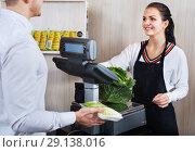Купить «Shopping assistant helping customer to weigh cabbage», фото № 29138016, снято 23 ноября 2016 г. (c) Яков Филимонов / Фотобанк Лори