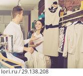 Купить «Couple purchasing jacket and dress», фото № 29138208, снято 24 октября 2016 г. (c) Яков Филимонов / Фотобанк Лори