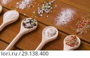 Купить «spoons with salt and spices on wooden table», видеоролик № 29138400, снято 20 сентября 2018 г. (c) Syda Productions / Фотобанк Лори