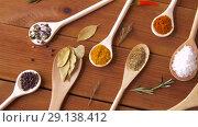 Купить «spoons with different spices on wooden table», видеоролик № 29138412, снято 20 сентября 2018 г. (c) Syda Productions / Фотобанк Лори