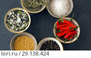 Купить «bowls with different spices on wooden table», видеоролик № 29138424, снято 20 сентября 2018 г. (c) Syda Productions / Фотобанк Лори