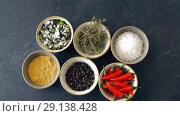 Купить «bowls with different spices on wooden table», видеоролик № 29138428, снято 20 сентября 2018 г. (c) Syda Productions / Фотобанк Лори