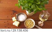 Купить «ingredients for basil pesto sauce on wooden table», видеоролик № 29138436, снято 20 сентября 2018 г. (c) Syda Productions / Фотобанк Лори