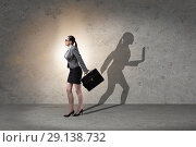 Купить «The businesswoman and his shadow in business concept», фото № 29138732, снято 17 февраля 2020 г. (c) Elnur / Фотобанк Лори