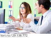 Купить «The two colleagues working in the office», фото № 29138772, снято 11 июня 2018 г. (c) Elnur / Фотобанк Лори