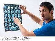 Купить «Young handsome doctor radiologyst working in hospital», фото № 29138964, снято 17 мая 2018 г. (c) Elnur / Фотобанк Лори