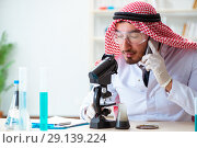 Купить «The arab chemist scientist testing quality of oil petrol», фото № 29139224, снято 21 апреля 2018 г. (c) Elnur / Фотобанк Лори