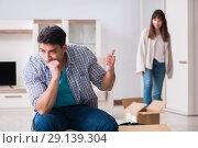 Купить «The woman evicting man from house during family conflict», фото № 29139304, снято 23 марта 2018 г. (c) Elnur / Фотобанк Лори