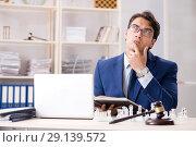 Купить «Young lawyer playing chess to train his court strategy and tacti», фото № 29139572, снято 31 июля 2018 г. (c) Elnur / Фотобанк Лори