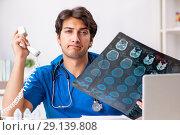Купить «The doctor in telemedicine concept with phone», фото № 29139808, снято 3 июля 2018 г. (c) Elnur / Фотобанк Лори