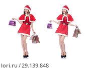Купить «The young woman in red santa costume on white», фото № 29139848, снято 24 августа 2013 г. (c) Elnur / Фотобанк Лори