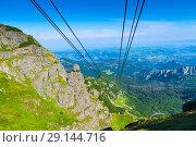 Купить «Cables of the funicular over the abyss in the Tatra mountains», фото № 29144716, снято 19 августа 2017 г. (c) Константин Лабунский / Фотобанк Лори