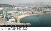 Купить «View from drone of Barceloneta beach with luxury hotel W Barcelona», видеоролик № 29147320, снято 29 августа 2018 г. (c) Яков Филимонов / Фотобанк Лори
