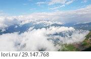 Купить «Caucasian mountains in early spring from Rosa Khutor resort in Russia», видеоролик № 29147768, снято 27 сентября 2018 г. (c) Володина Ольга / Фотобанк Лори