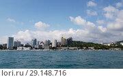 Купить «Sochi, Russia - June 2. 2018. View from sea to seaport building,», видеоролик № 29148716, снято 28 сентября 2018 г. (c) Володина Ольга / Фотобанк Лори