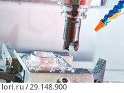 Купить «Milling metalworking. Industrial CNC metal machining by vertical mill.», фото № 29148900, снято 16 мая 2018 г. (c) Дмитрий Калиновский / Фотобанк Лори