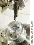 Купить «Milling metalworking process. CNC metal machining by mill.», фото № 29148904, снято 16 мая 2018 г. (c) Дмитрий Калиновский / Фотобанк Лори