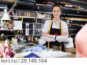 Купить «Portrait of woman designer who is standing on her workplace in time designing new collection», фото № 29149164, снято 5 мая 2018 г. (c) Яков Филимонов / Фотобанк Лори