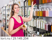 Купить «woman take a choise fresh liquid soap in perfume supermarket», фото № 29149204, снято 2 мая 2017 г. (c) Яков Филимонов / Фотобанк Лори