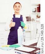 Купить «Cleaner standing in protective uniform at office», фото № 29149328, снято 16 октября 2018 г. (c) Яков Филимонов / Фотобанк Лори