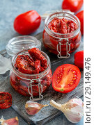 Dried tomatoes with herbs and olive oil. Стоковое фото, фотограф Марина Сапрунова / Фотобанк Лори