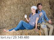 Купить «man and woman in hay with milk», фото № 29149480, снято 22 марта 2019 г. (c) Яков Филимонов / Фотобанк Лори