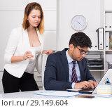 Купить «Business couple flirting in office», фото № 29149604, снято 1 июня 2017 г. (c) Яков Филимонов / Фотобанк Лори