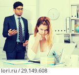 Купить «Frustrated business woman with angry chief», фото № 29149608, снято 1 июня 2017 г. (c) Яков Филимонов / Фотобанк Лори
