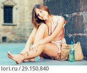 Купить «young girl in romantic dress sitting in town», фото № 29150840, снято 26 августа 2017 г. (c) Яков Филимонов / Фотобанк Лори