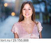 Купить «close-up portrait of smiling slim adult girl in sexy evening apparel», фото № 29150888, снято 26 августа 2017 г. (c) Яков Филимонов / Фотобанк Лори