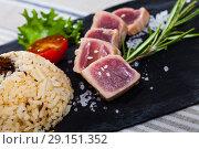 Купить «Tuna tataki with garnish of rice», фото № 29151352, снято 19 ноября 2018 г. (c) Яков Филимонов / Фотобанк Лори