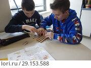 Купить «8th Grade Special Education Boys Working on Project, Wellsville, New York, USA.», фото № 29153588, снято 1 февраля 2018 г. (c) age Fotostock / Фотобанк Лори