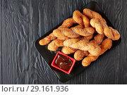 Купить «Kkwabaegi with sugar on a plate», фото № 29161936, снято 5 сентября 2018 г. (c) Oksana Zh / Фотобанк Лори