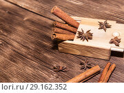 Купить «Food, Asian spices. Cinnamon sticks and cardamom on the background of a wooden table in a rustic style», фото № 29162352, снято 9 сентября 2018 г. (c) Светлана Евграфова / Фотобанк Лори