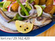 Stewed in white wine Blue Whiting fish. Стоковое фото, фотограф Яков Филимонов / Фотобанк Лори