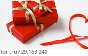 Купить «gifts wrapping into red paper for valentines day», видеоролик № 29163240, снято 30 сентября 2018 г. (c) Syda Productions / Фотобанк Лори