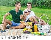 Купить «Two adult pacified males enjoying picnic», фото № 29165416, снято 23 августа 2017 г. (c) Яков Филимонов / Фотобанк Лори