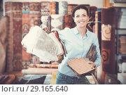 Купить «Female choosing carpet samples», фото № 29165640, снято 22 ноября 2017 г. (c) Яков Филимонов / Фотобанк Лори